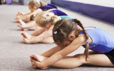 young gymnasts performing warming up routine