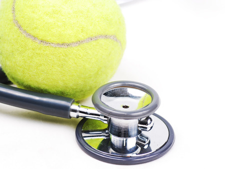 25226706 - stethoscope and tennis ball on isolate
